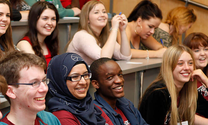 smiling students at lecture