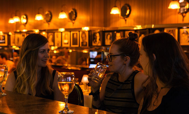 Female friends having a drink in a bar