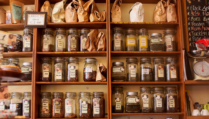 Shelves packed with tea-leaf jars and packets